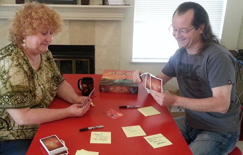 Team playing Dixit retrospective game
